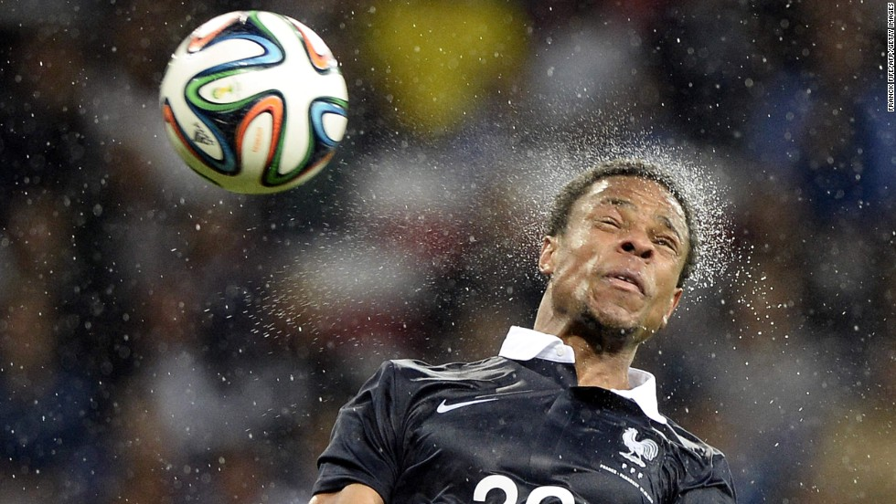 French forward Loic Remy jumps for a header Sunday, June 1, during an international friendly match against Paraguay in Nice, France. The World Cup warm-up for France ended in a 1-1 draw.