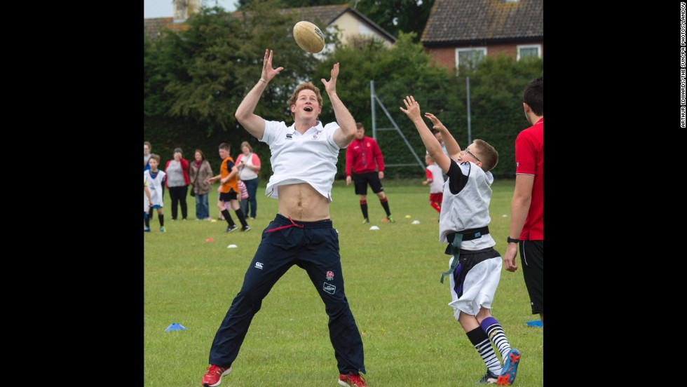 Britain's Prince Harry enjoys a game of touch rugby Thursday, May 29, at the Inspire Suffolk center in Ipswich, England. Inspire Suffolk is a local charity that uses sports to motivate and educate young children.