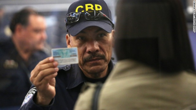 A U.S. Customs officer checks a person's ID at San Ysidro, California, where Sgt. Andrew Tahmooressi crossed into Mexico.