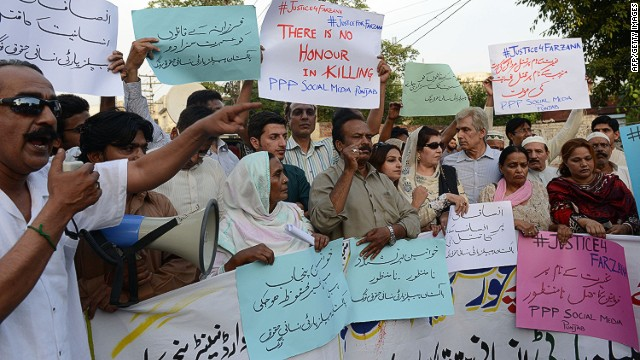 "Pakistani activists from the PPP Social Media hold placards as they chant slogans during a protest against the killing of pregnant woman Farzana Parveen was beaten to death with bricks by members of her own family for marrying a man of her own choice in Lahore on May 30, 2014. Pakistani police investigating the murder of a woman bludgeoned to death outside a court have arrested four men, a senior officer said, as her husband said he wanted her killers to ""die in pain"". AFP PHOTO/Arif ALIArif Ali/AFP/Getty Images"