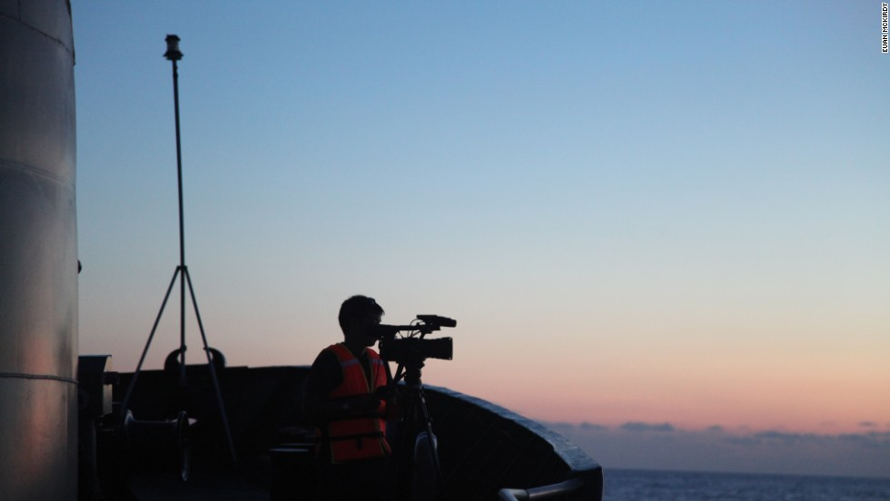 A cameraman films from the bow of CG8003.