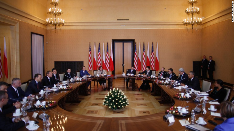 Obama, at right, is seated with a U.S. delegation as he participates in a bilateral meeting with Polish Prime Minister Donald Tusk and the Polish delegation in Warsaw on June 3. While in Poland, Obama announced he would ask Congress for $1 billion to be put toward bolstering NATO's security alliance in Europe.