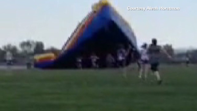 Watch another bounce house go airborne