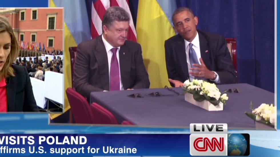 Obama vows to stand with Ukraine as he meets President-elect in Poland