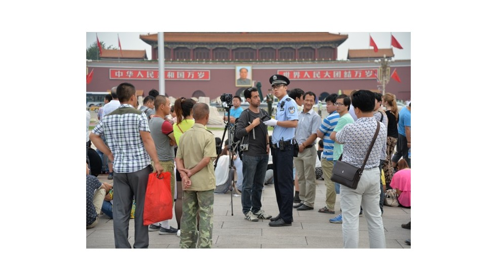 A foreign photographer is questioned and eventually taken away from Tiananmen Square on June 4.