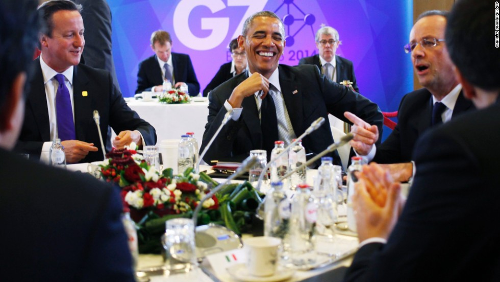 President Obama laughs with British Prime Minister David Cameron, left, and Hollande during a G7 session in Brussels, Belgium, on Thursday, June 5.
