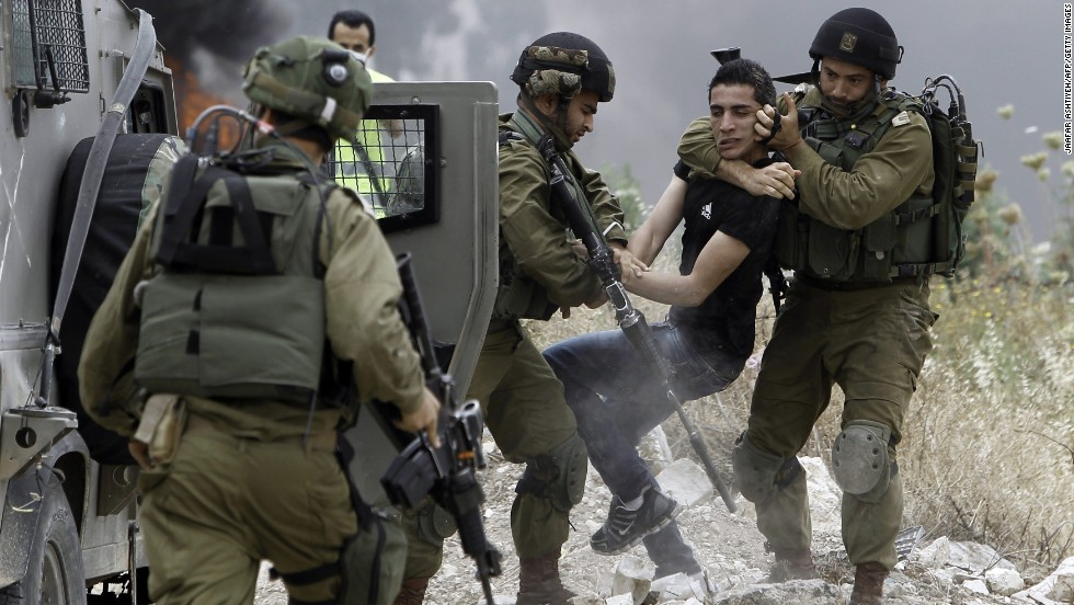 Israeli soldiers in the West Bank town of Tulkarem detain a Palestinian who was protesting land expropriation on Saturday, May 31.