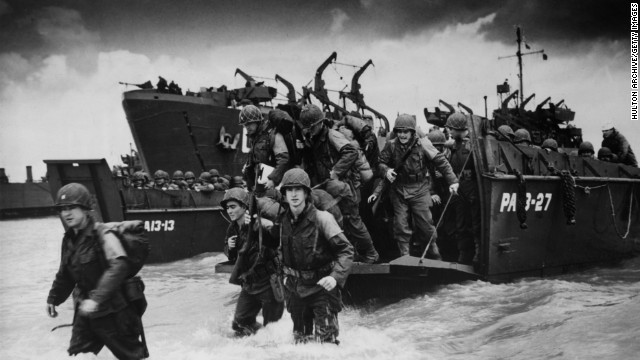 Reinforcements disembarking from a landing barge at Normandy during the Allied Invasion of France on D-Day June 6, 1944.
