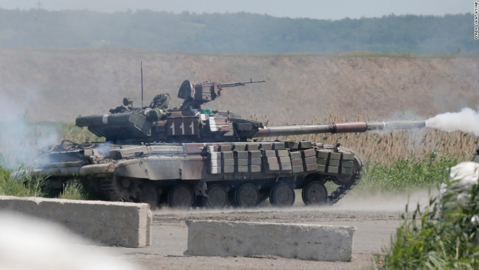 A Ukrainian tank opens fire during a battle with pro-Russian separatist fighters in Slovyansk on Friday, June 6.