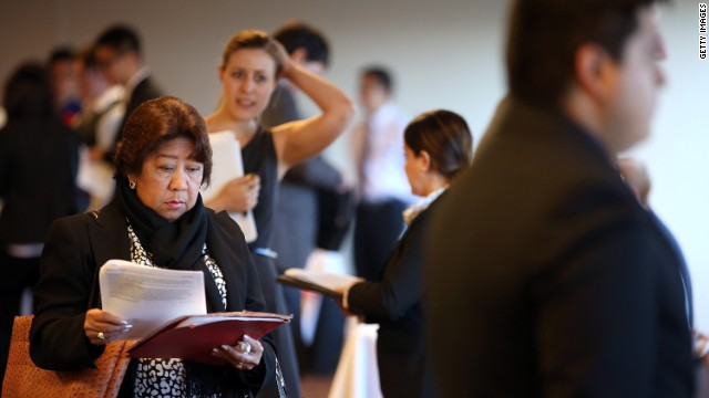 Job seekers wait in line to meet with recruiters during a HireLive career fair on June 4, 2014 in San Francisco, California. According to a report by payroll processor ADP, 179,000 private sector jobs were added in May, falling short of economists expectations of 215,000.