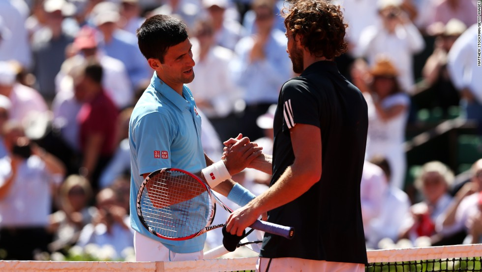 Djokovic and Gulbis embrace at the end of the match at a sun kissed Roland Garros. Djokovic will now aim to become only the eighth man to complete a career grand slam in Sunday's final.