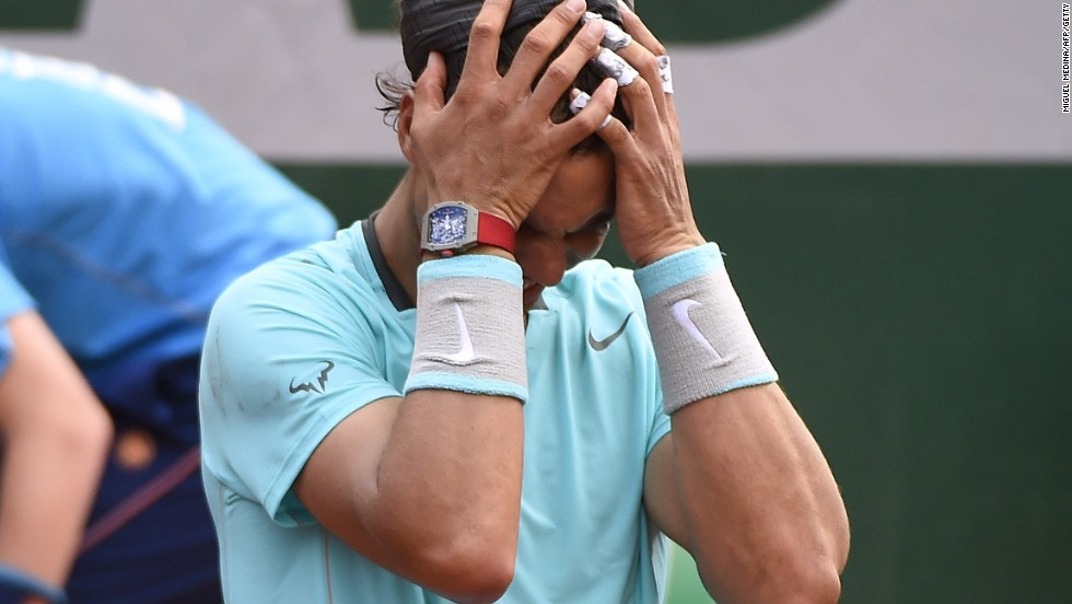 Rafael Nadal sinks to his knees in triumph after his four-set victory over Novak Djokovic in the French Open final.