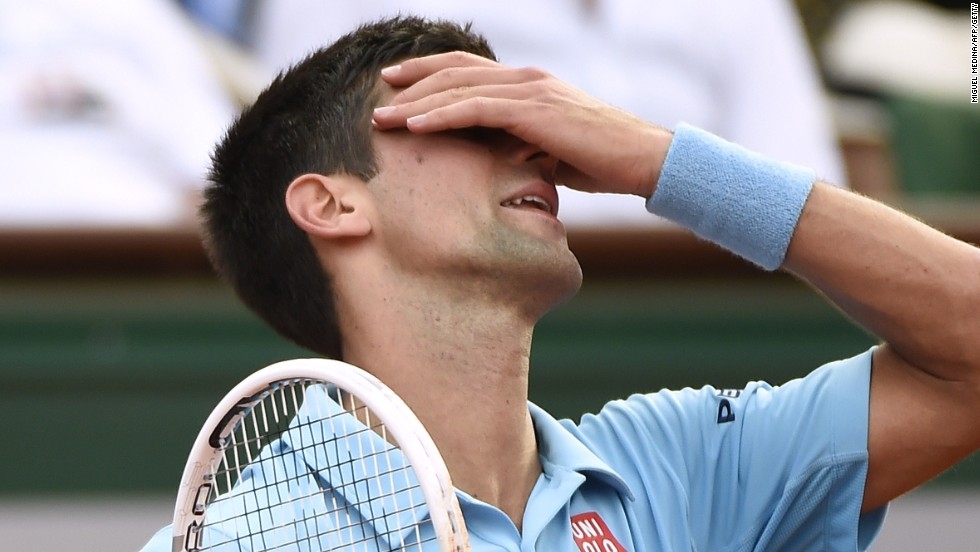 The desperation shows on Djokovic's face after his victory hopes slip away on Philippe Chatrier.