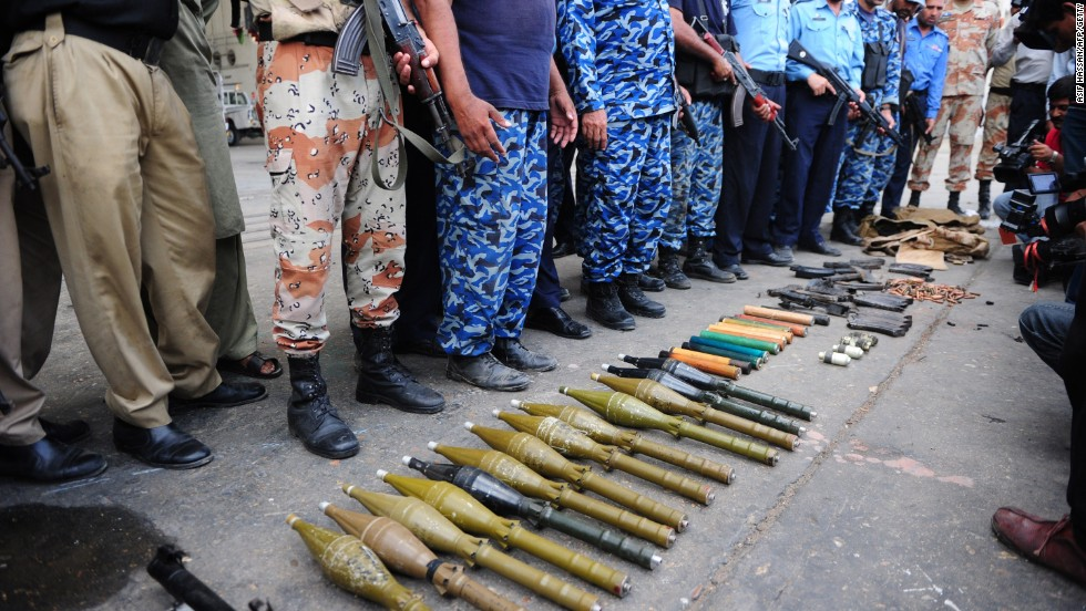 Pakistani police display weapons seized from militants in the attack on June 9.