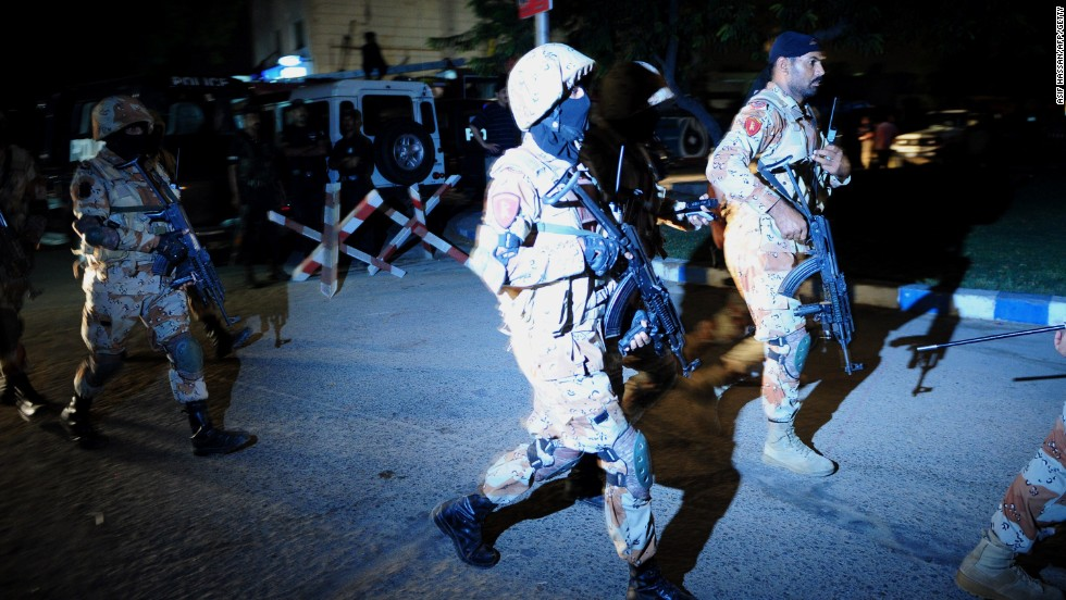 Pakistani security personnel arrive at the site of the airport attack on June 8.
