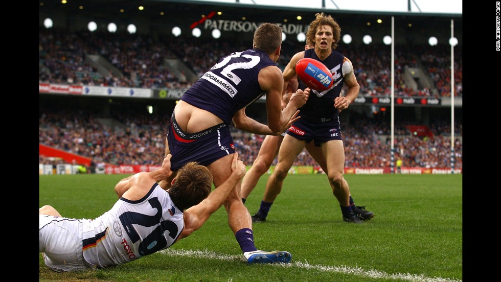 Richard Douglas of the Adelaide Crows tries to tackle Stephen Hill of the Fremantle Dockers during an Australian Football League match Sunday, June 8, in Perth, Australia.