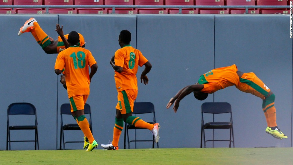 Zambia's Christopher Katongo, far left, flips in the air after scoring a goal against Japan in an international friendly match Friday, June 6, in Tampa, Florida. Japan won 4-3 in what was its final warm-up match for the World Cup.