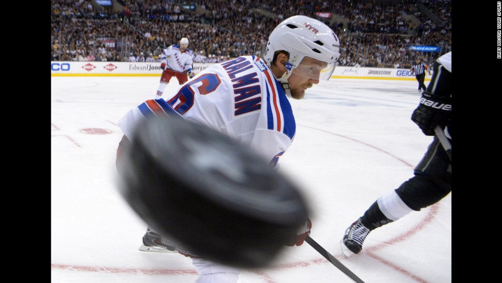 New York Rangers defenseman Anton Stralman watches a hockey puck fly into a corner of the rink Wednesday, June 4, in Game 1 of the NHL's Stanley Cup Final. The Rangers lost 3-2 in overtime to the Los Angeles Kings.