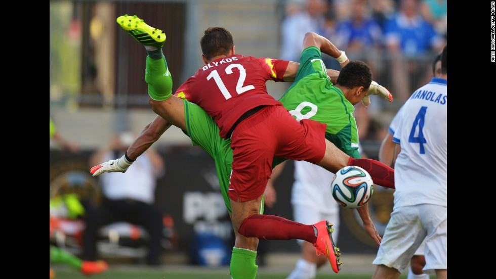 Greece goalkeeper Panagiotis Glykos gets tangled up with Nigeria forward Peter Odemwingie during an international friendly match Tuesday, June 3, in Chester, Pennsylvania. The game, a World Cup warm-up for both teams, finished 0-0.