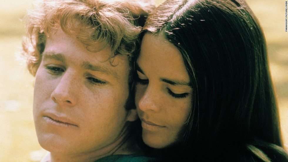 "<strong>""Love Story"" (1970):</strong> If you were around when Ryan O'Neal and Ali MacGraw starred in ""Love Story,"" then you have an idea of what's going on in theater showings of ""The Fault in Our Stars."" The stories aren't too dissimilar: Young love blossoms against all odds and then -- boom! -- tragedy hits. Why this basic story makes us cry every time, we have no idea."