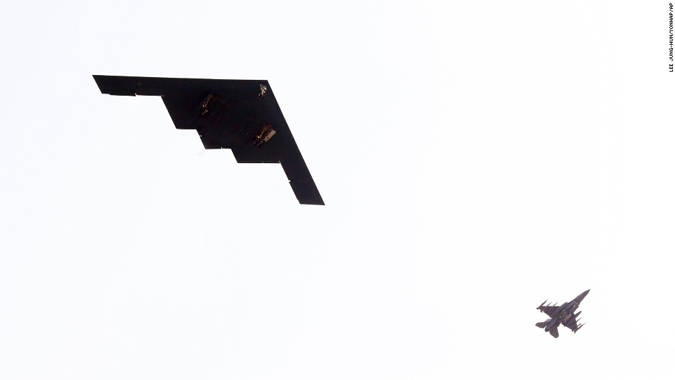 A B-2, left, flies near Osan Air Base in Pyeongtaek, South Korea, in March 2013. The B-2 has a wingspan of 172 feet, a length of 69 feet and a height of 17 feet.