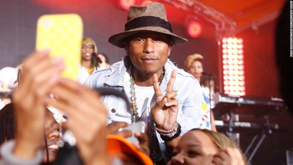 "Musician Pharrell Williams flashes the peace sign for a photo taken Thursday, June 5, during an appearance on NBC's ""Today"" show."