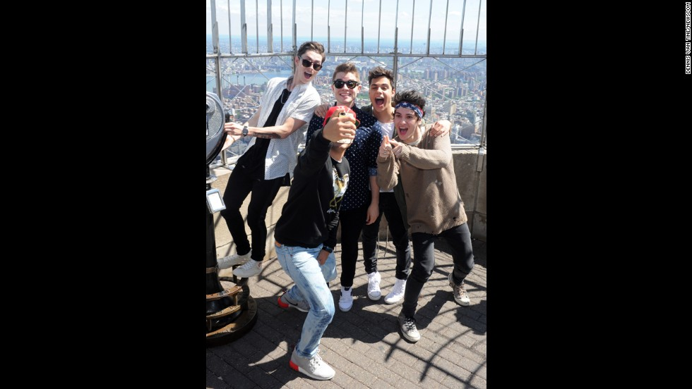 The boy band Midnight Red takes a photo during a visit to the Empire State Building in New York on Thursday, June 5.
