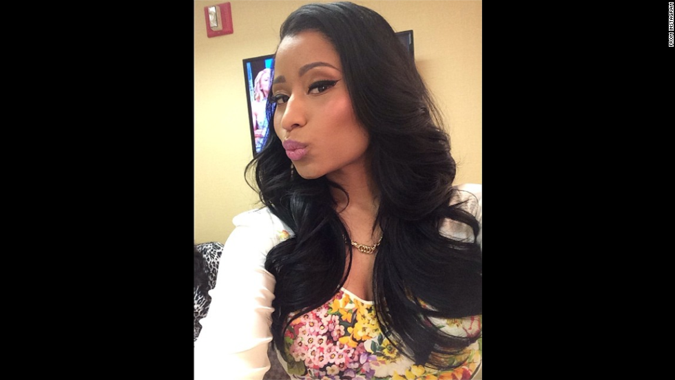 "Rapper Nicki Minaj <a href=""http://instagram.com/p/pBr-IIr8W8/"" target=""_blank"">posted a smooch</a> on her Instagram account Monday, June 9. <a href=""http://www.cnn.com/2014/06/04/world/gallery/look-at-me-0604/index.html"">See 22 selfies from last week</a>"