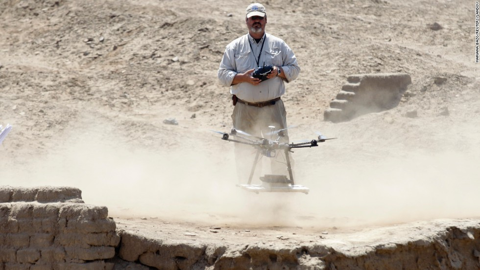 Luis Jaime Castillo, a Peruvian archaeologist, uses a drone to take pictures of the archaeological site of San Jose de Moro in Trujillo on July 18, 2013. In Peru, home to Machu Picchu and thousands of ancient ruins, archaeologists are turning to drones to speed up sluggish survey work and protect sites from squatters, builders and miners.