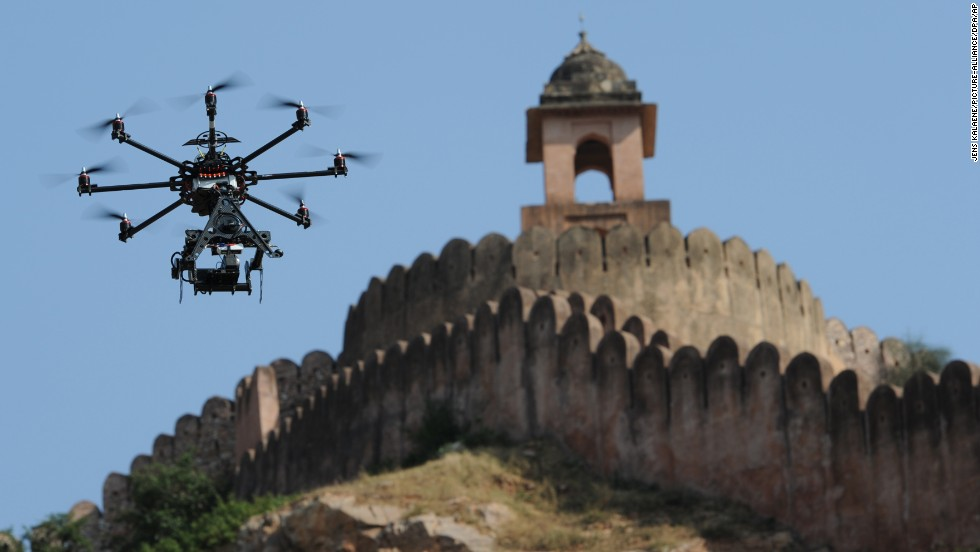 "A drone fitted with a film camera shoots aerial footage during the production of the film ""The Girl with the Indian Emerald"" in Jaipur, India, on November 7, 2012. While it's already being done in other countries, the U.S. government is considering <a href=""http://www.cnn.com/2014/06/04/tech/innovation/movies-drones-faa/index.html"">a request from movie and TV producers</a> to let them use unmanned aircraft to shoot aerial video."