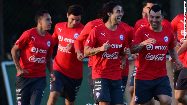 Chile's squad warm up during a training session at Toca da Raposa in Belo Horizonte on June 10, 2014, two days before the start of the 2014 FIFA World Cup.