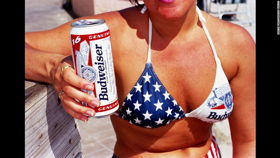 A woman wears a patriotic bikini that also has the Budweiser beer logo in 1997.