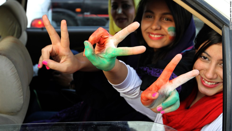 Fans celebrate in northern Tehran after Iran won their 2014 World Cup Asian zone group A qualifying football match against South Korea to qualify for the  World Cup.