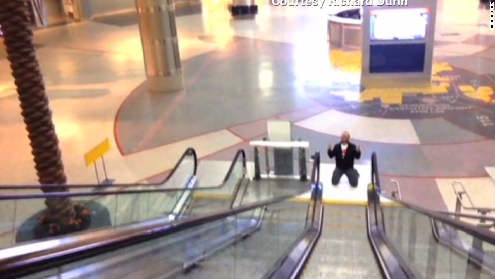 Guy films airport video 'All By Myself' - CNN Video