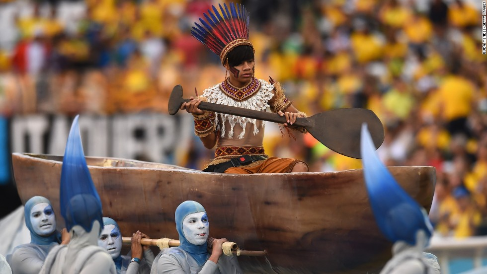 A performer is carried in a boat during the opening ceremony.