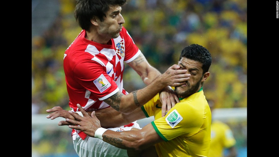 Croatia's Vedran Corluka, left, clashes with Hulk during the first half.