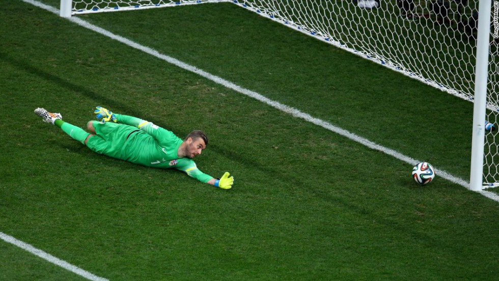 Croatian goalkeeper Stipe Pletikosa dives but fails to stop the ball as Neymar scores his first goal to tie the match at 1-1.