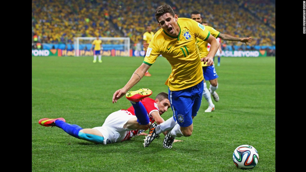 Oscar is tripped up by Croatia's Sime Vrsaljko during the second half.