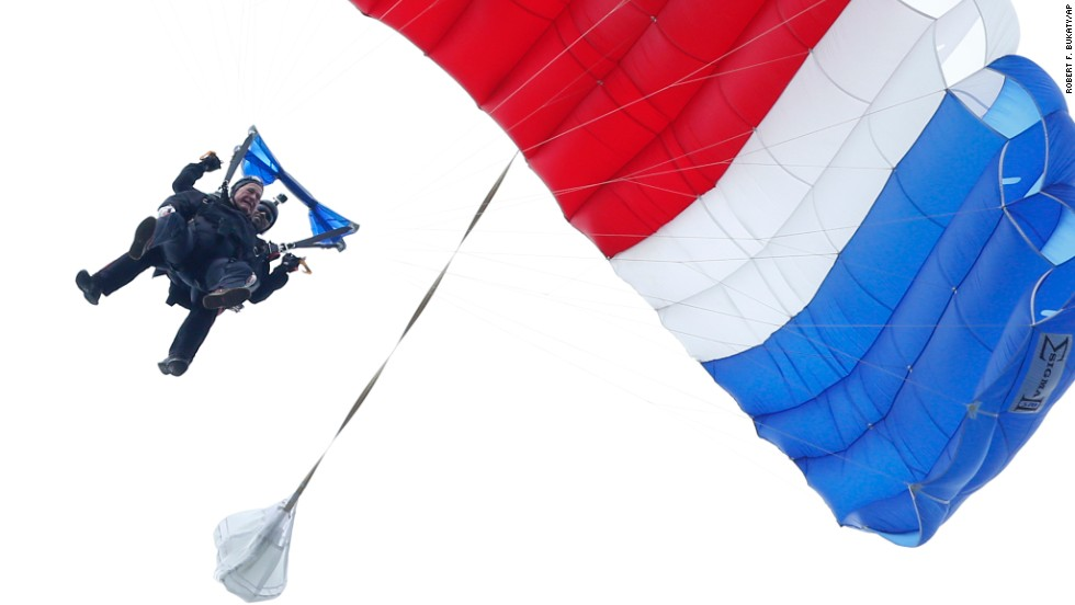 Bush floats to the ground in June 2014 during a tandem parachute jump near his home in Kennebunkport, Maine. Bush was strapped to Mike Elliott, a retired member of the Army's Golden Knights parachute team, as he made the jump to celebrate his 90th birthday.