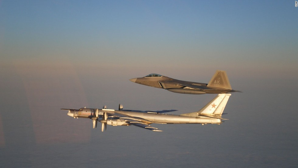 A U.S. Air Force F-22 Raptor, top, escorts a Russian Air Force Tu-95 bomber off the coast of Alaska in 2011.