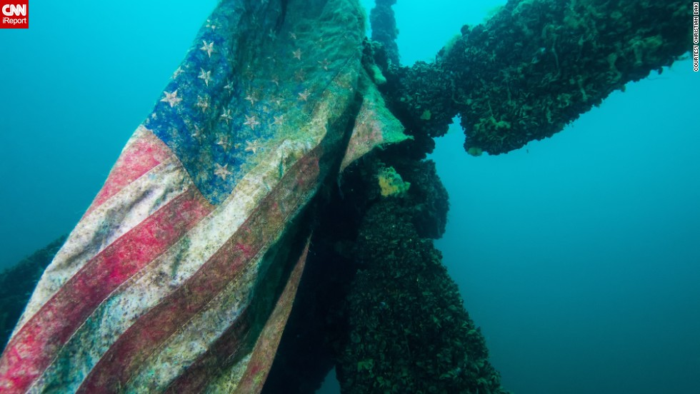 "While diving in Dutch Springs in Bethlehem, Pennsylvania, <a href=""http://ireport.cnn.com/docs/DOC-1142723"">Christian Baki</a> found this American flag still attached to a Sikorsky H-37 helicopter that was submerged in the freshwater quarry."