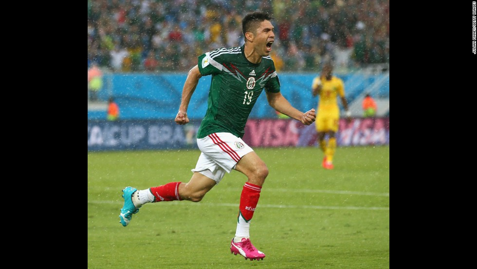 Oribe Peralta celebrates after scoring the only goal in Mexico's 1-0 win over Cameroon on June 13 in Natal, Brazil.