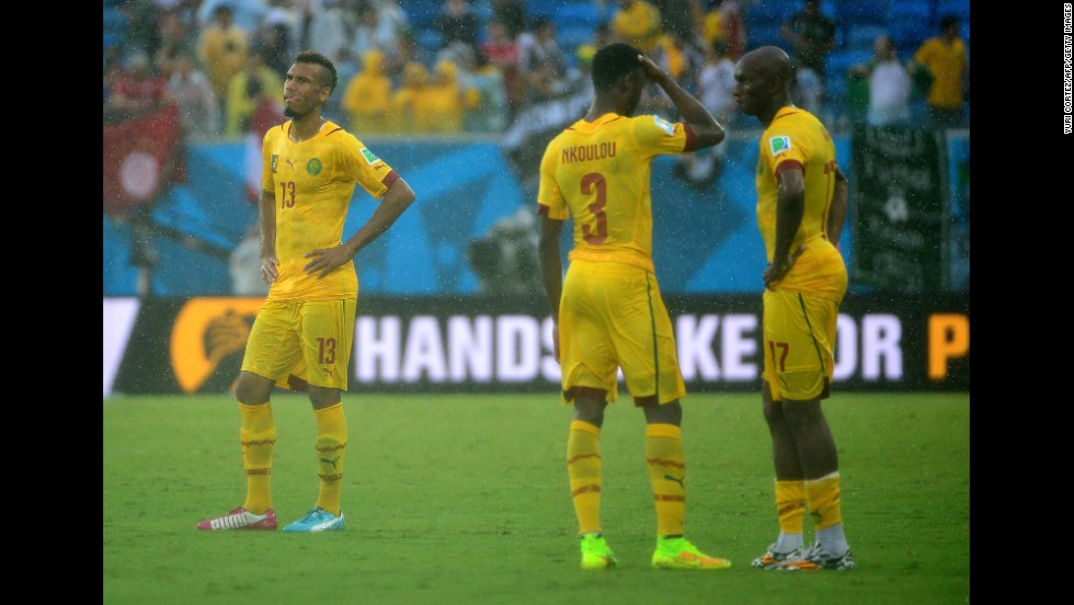From left, Cameroon players Eric Maxim Choupo-Moting, Nicolas N'Koulou and Stephane Mbia react at the end of match.