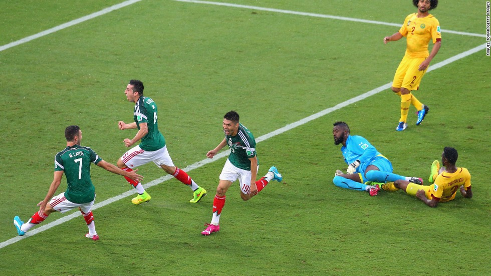Peralta, third from left, celebrates his goal with teammates Miguel Layun, left, and Hector Herrera as Cameroon players look on in the second half.