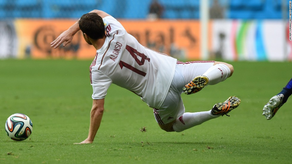 Spanish midfielder Xabi Alonso takes a fall during the first half.