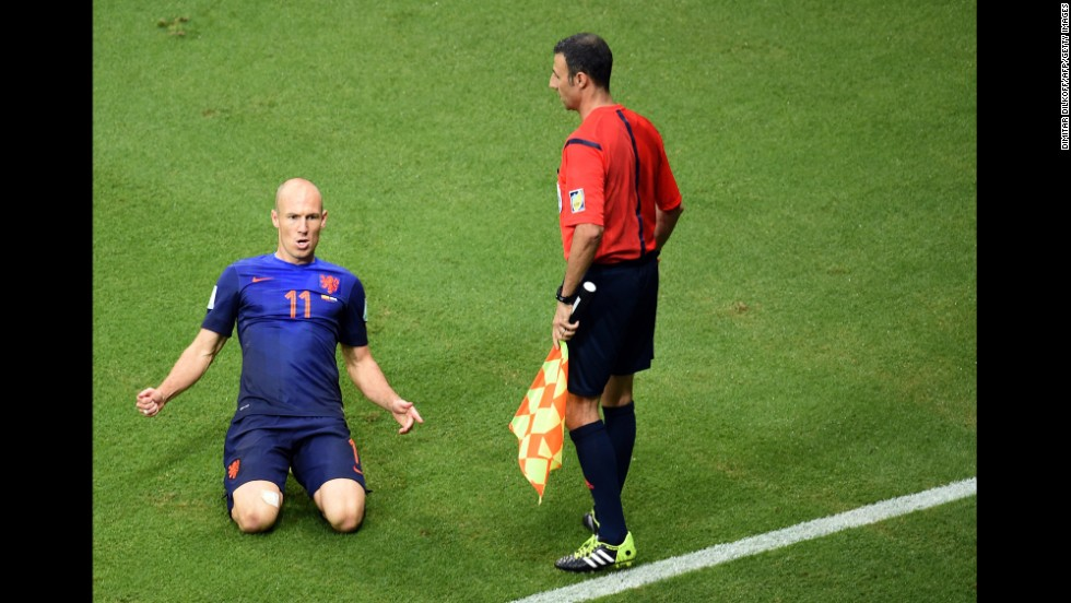 Robben slides on the ground after scoring his first goal. It gave the Dutch a 2-1 lead in the second half.