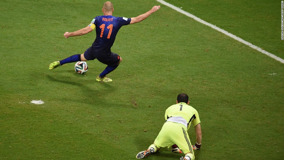 Dutch forward Arjen Robben scores the final goal in the Netherlands' victory. Robben had two goals in the match.