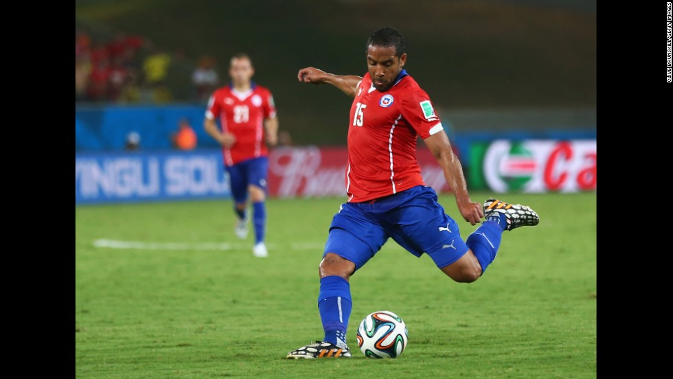 Jean Beausejour of Chile shoots and scores the final goal during his team's 3-1 win over Australia on Friday, June 13, in Cuiaba, Brazil.