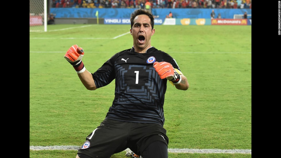 "Goalkeeper Claudio Bravo of Chile celebrates after his team scored at the end of the match against Australia on Friday, June 13. Chile won 3-1. Friday was the second day of the soccer tournament, which is being held in 12 cities across Brazil. <a href=""http://www.cnn.com/2014/06/12/football/gallery/world-cup-0612/index.html"" target=""_blank"">See Thursday's best photos</a>"