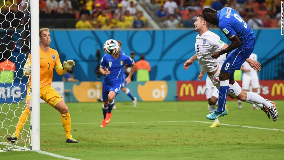 Mario Balotelli scores Italy's second goal, beating England defender Gary Cahill to a cross and heading the ball past goalkeeper Joe Hart.